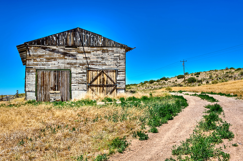 Abandoned barn over historic Route 66 in Arizona, United States.