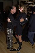 Hamid Bechiri and Eva Herzagova. Azzadine Alaia installation. 575 Broadway. NY. 22 September 2000. © Copyright Photograph by Dafydd Jones 66 Stockwell Park Rd. London SW9 0DA Tel 020 7733 0108 www.dafjones.com