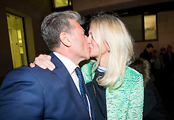 © Licensed to London News Pictures. 14/12/2015. London, UK. Radio DJ NEIL FOX, aka Dr Fox, kissing his wife VICKY FOX as he leaves Westminster Magistrates Court in London, where he was found not guilty on 10 separate charges of indecent assault and sexual assault. Photo credit: Ben Cawthra/LNP