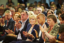© Licensed to London News Pictures.  19/07/2014. Milton Keynes, UK. Labour party members including shadow chancellor Ed Balls (left of centre) listen to a speech by leader Ed Miliband (not seen) at the 2014 National Policy Forum (NPF) being held at the Kents Hill Training Centre in Milton Keynes. Photo credit: Cliff Hide/LNP