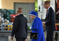 Lord Lieutenant of greater London Ken Olisa (left) greets Queen Elizabeth II and the Duke of Cambridge as they arrive to meet members of the community affected by the fire at Grenfell Tower in west London during a visit to the Westway Sports Centre which is providing temporary shelter for those who have been made homeless in the disaster.
