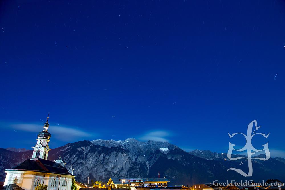 A view of the moonlit Austrian Alps over Götzens, Austria.