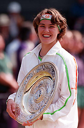 All smiles fom Martina Hingis on Centre Court this afternoon (Saturday) after she won the Ladies' Singles Final from Jana Novotna. Photo by Adam Butler/PA.