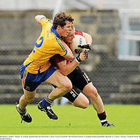 25 June 2011; Brendan Coulter, Down, in action against Kevin Hartnett, Clare. GAA Football All-Ireland Senior Championship Qualifier Round 1, Clare v Down, Cusack Park, Ennis, Co. Clare. Picture credit: Pat Murphy / SPORTSFILE