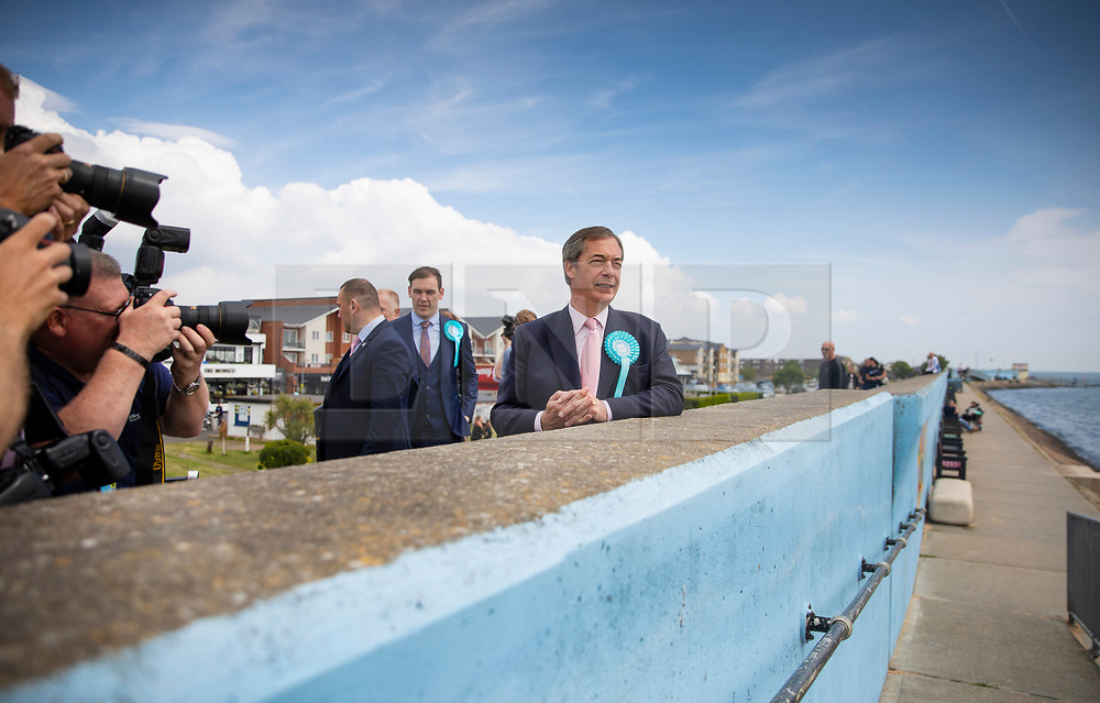 © Licensed to London News Pictures. 18/05/2019. Canvey Island, UK. Brexit Party leader Nigel Farage looks out from the sea wall as he campaigns for the European Elections in Canvey Island, Essex. The European Elections are being held on Thursday 23rd May. Photo credit: Peter Macdiarmid/LNP