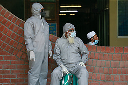 People wearing protective suits wait to be tested, amid the COVID-19 outbreak, at the Shaheed Suhrawardy Medical College and Hospital in Dhaka, Bangladesh, April 19, 2020. Photo by Suvra Kanti Das/ABACAPRESS.COM