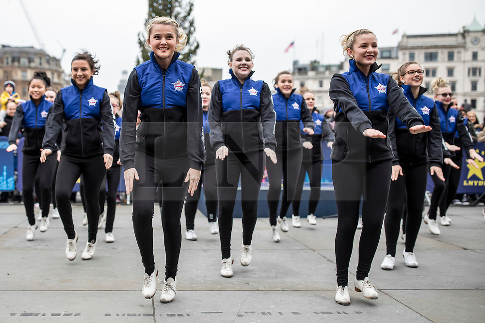 © Licensed to London News Pictures. 30/12/2018. London, UK. America's Clogging All-Stars, drawn from across the southern states of the USA, perform at a preview ahead of the London New Year's Day Parade in Trafalgar Square. More than 8,000 performers from 26 countries will take part in the parade on 1st January 2019. Photo credit: Rob Pinney/LNP