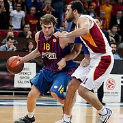 Galatasaray's Cevher OZER (R) and  FC Barcelona Regal's C.J.WALLACE (L) during their Euroleague group D matchday 5 Galatasaray between  FC Barcelona Regal at the Abdi Ipekci Arena in Istanbul at Turkey on Thursday, November 17 2011. Photo by TURKPIX