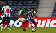 Jesús Manuel Corona of Porto in action with Getterson of Maritimo during the Portuguese League (Liga NOS) match between FC Porto and Maritimo at Estadio do Dragao, Porto, Portugal on 3 October 2020.