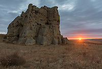 The sun rises beyond Castle Rock on the eastern Montana prairie. The sun was only visible for a couple minutes on this mostly cloudy morning. As far as I know Castle Rock is the only rock formation in this state park that has a name.