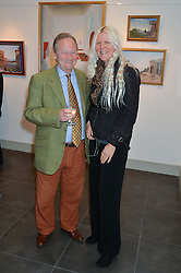 KEITH HOLLAND and IMOGEN BREWER at a private view of work by artist Philip Bouchard at 508 Gallery, 508 King's Road, London on 3rd April 2014.