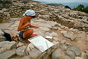 GREECE, CRETE Gournia site of a Minoan town from the Late Minoan I period (1550-1450 BC); an archaeologist mapping the site