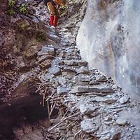 Meredith Wiltsie checks out a precarious trail beside the Kali Gandaki River in Nepal.