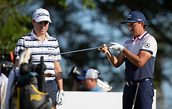February 28, 2019 - Palm Beach Gardens, Florida, U.S. - Rickie Fowler check  Justin Thomas's nine iron after Thomas hit the club again a tree on the 10th hole during the first round of the Honda Classic Thursday at PGA National Resort and Spa in Palm Beach Gardens, February 28, 2019. (Credit Image: © Allen Eyestone/The Palm Beach Post via ZUMA Wire)