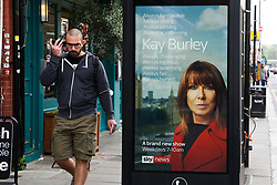 © Licensed to London News Pictures. 07/09/2020. London, UK. A man walks past a digital advert featuring Sky Newsreader, KAY BURLEY, in north London. KAY BURLEY will host a new breakfast programme on Sky News from 7am-9am Mondays to Thursdays from October 14 to coincide with MPs returning to Parliament amid the countdown to Brexit. Photo credit: Dinendra Haria/LNP