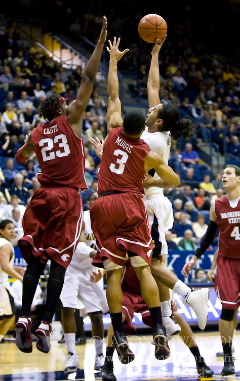 February 13, 2010; Berkeley, CA, USA;  Washington State Cougars forward DeAngelo Casto (23) and guard Reggie Moore (3) defend a shot from California Golden Bears guard Jorge Gutierrez (2) during the first half at the Haas Pavilion.  California defeated Washington State 86-70.