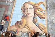Chalk artist Gabrielle Abbott (right) paints Botticelli's Venus with pastels on the Westlake Center Plaza in Seattle, Washington.