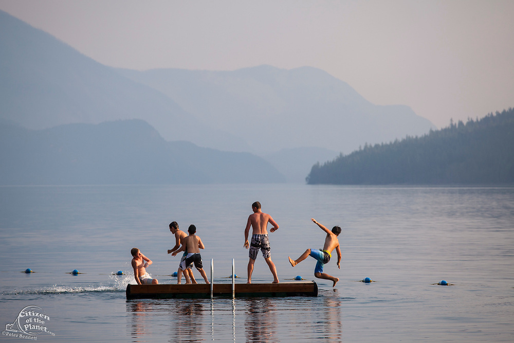 Young boys playing on Slocan Lake, New Denver, Slocan Valley, West Kootenay, British Columbia, Canada