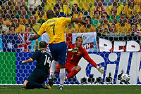 Photo: Glyn Thomas.<br />Brazil v Australia. Group F, FIFA World Cup 2006. 18/06/2006.<br /> Brazil's Adriano (C) gives his team a 1-0 lead.