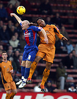 Photo: Chris Ratcliffe.<br />Crystal Palace v Wolverhampton Wanderers. Coca Cola Championship. 10/12/2005.<br />Andy Johnson (L) and  Jolean Lescott compete for a header