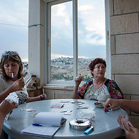 Firouz Shimolay's three sisters play cards on the porch of her home in Beit Sahour, near Bethlehem in the West Bank. The family is part of the ancient Palestinian Christian community in this town. Two of the sisters have already emigrated (one to Texas and one to Australia) and the third has plans to emigrate to South America citing the poor economy and continuing Israeli occupation of the West Bank as the motives for their move.