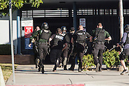 Shooting in San Bernardino.<br /> Local San Bernardino are SWAT team members storm a school after shooters engaged the police less than a block away.