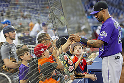 March 28, 2019 - Miami, Fl - Colorado Rockies center field Ian Desmond (20) signs autographs for fans before the start of an Opening Day baseball game between the Colorado Rockies and the Miami Marlins at Marlins Park on Thursday, March 28, 2019 in Miami, Florida. (Credit Image: © Matias J. Ocner/Miami Herald/TNS via ZUMA Wire)