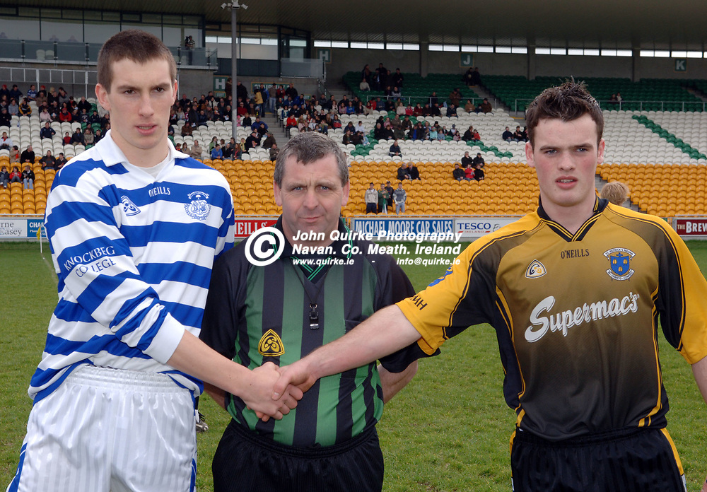 """10-03-07. St. Patrick's Classical School, Navan v Knockbeg College, Carlow - Leinster Colleges SFC """"A"""" final at Tullamore.<br /> Knockbeg captain, Sean Ramsbottom and St. Pat's captain, David Maguire shaking hands with referee Eugene Murtagh, Longford in the centre.<br /> Photo: John Quirke.<br /> ©John Quirke Photography, Unit 17, Blackcastle Shopping Cte.<br /> Navan. Co. Meath. 046-9079044 / 087-2579454."""
