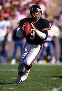 CHICAGO,IL-UNDATED:  NFL quarterback Jim McMahon of the Chicago Bears scrambles with the ball during a game at Soldier Field in Chicago Illinois.  McMahon played for the Chicago Bears from 1982-1988.  (Photo by Ron Vesely)