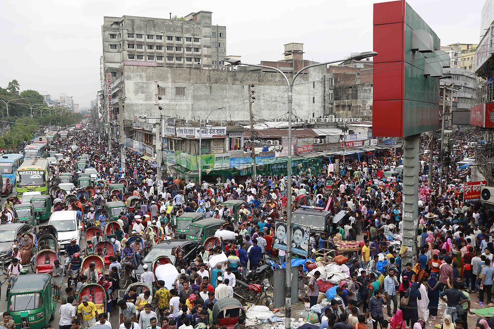May 24, 2019 - Dhaka, Bangladesh - City dwellers thronged into shopping malls and makeshift shops on Friday for their Eid shopping ahead of the holy Eid-ul-Fitr, the biggest festival of the year for Muslims, in Dhaka, Bangladesh, May 24, 2019. All the shopping malls in New Market, Panthapath, Dhanmondi, Farmgate, Gausia, Elephant Road, Mirpur, Uttara, Gulshan and other parts of the city were buzzed with the presence of Eid shoppers. Consequently, commuters faced huge traffic gridlocks as most of the streets were packed with vehicles. (Credit Image: © Suvra Kanti Das/ZUMA Wire)