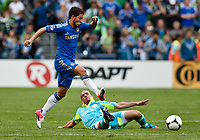 Chelsea FC midfielder Eden Hazard leaps over Seattle Sounders FC midfielder Osvaldo Alonso during the 2nd half at CenturyLink Field.