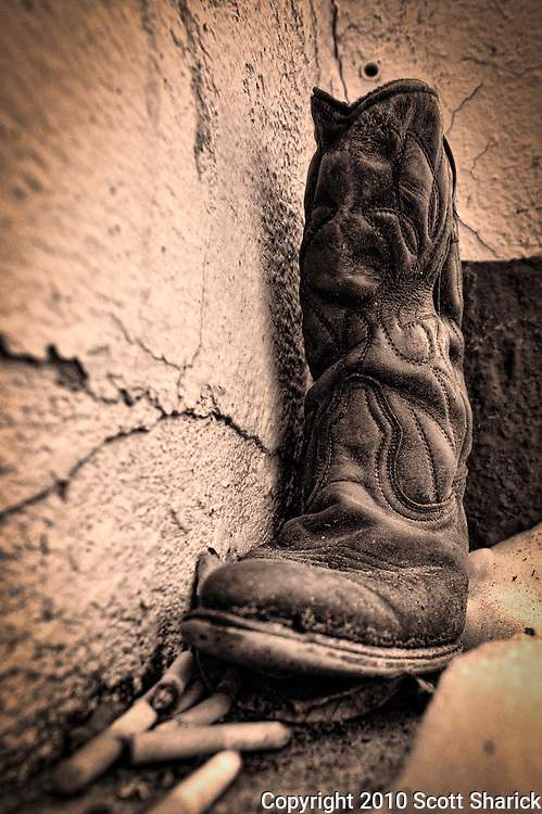 The patrons of a tattoo parlor in Butte, Montana use this boot as a cigarette butt receptacle. The inside of the boot had its fair share of butts. Missoula Photographer, Montana Photographer, Pictures of Missoula, Montana Photos