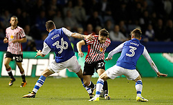 Sunderland's Lynden Gooch battles for the ball with Sheffield Wednesday's Daniel Pudil (left) and David Jones (right), during the Sky Bet Championship match at Hillsborough, Sheffield.