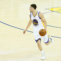 04 June 2017: Golden State Warriors guard Klay Thompson (11) brings the ball up court during the Golden State Warriors 132-113 victory over the Cleveland Cavaliers, in game 2 of the 2017 NBA Finals, at the Oracle Arena, Oakland, California, USA.