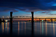 Sunsets as long shadows darken the Cape Fear River and the historic Cape Fear Bridge in Wilmington, North Carolina. Photos By Jeff Janowski Photography