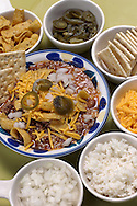 KEVIN BARTRAM/The Daily News.Joanie Schirmer's chili and toppings are shown on Friday, March 4, 2005.