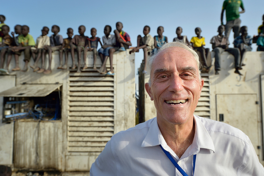 Father Mike Bassano, a Maryknoll priest from the United States, lives inside a United Nations base in Malakal, South Sudan. More than 20,000 civilians have lived inside the base since shortly after the country's civil war broke out in December, 2013, but renewed fighting in 2015 drove another 5,000 people into the relative safety of the camp. Bassano, also a member of Solidarity with South Sudan, lives in the camp to accompany the people there.