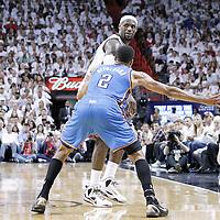 19 June 2012: Miami Heat small forward LeBron James (6) looks to pass the ball past Oklahoma City Thunder shooting guard Thabo Sefolosha (2) during the Miami Heat 104-98 victory over the Oklahoma City Thunder, in Game 4 of the 2012 NBA Finals, at the AmericanAirlinesArena, Miami, Florida, USA.