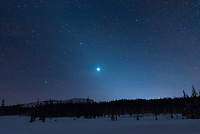 After the sun set over the Absaroka Mountains, Venus became brighter and the zodiacal light began to glow vividly all around it. The diffuse, diagonal glow is caused by the sun illuminating dust particles within the solar system.