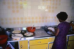 Muchacha Washing Dishes In The Kitchen
