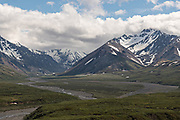 View of the East Fork river across the tundra with the Alaska Mountains in Denali National Park Alaska. Denali National Park and Preserve encompasses 6 million acres of Alaska's interior wilderness.