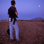Members of a loose knit group of volunteers patrol near the U.S.-Mexico border for undocumented migrants crossing into the United States through the desert of Arizona. The group is affiliated with Chris Simcox who helped form the Minute Men. Please contact Todd Bigelow directly with your licensing requests.
