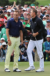 April 8, 2018 - Augusta, GA, USA - Jordan Spieth, right, and Justin Thomas on 18 after Spieth  bogied to fall to 13 under for the round during the final round of the Masters at Augusta National Golf Club on Sunday, April 8, 2018, in Augusta, Ga. (Credit Image: © Curtis Compton/TNS via ZUMA Wire)