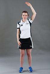 Umpire Louise Travis signalling caution