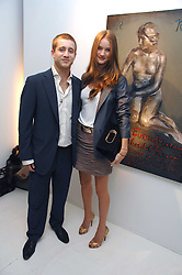 ROSIE HUNTINGTON-WHITELEY and TYRONE WOOD at an exhibition of paintings by artist Rene Richard at the Scream Gallery, Bruton Street, London on 3rd April 2008.<br /><br />NON EXCLUSIVE - WORLD RIGHTS