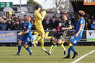 Bristol Rovers goalkeeper Adam Smith (21) saves from AFC Wimbledon striker Cody McDonald (10) during the EFL Sky Bet League 1 match between AFC Wimbledon and Bristol Rovers at the Cherry Red Records Stadium, Kingston, England on 17 February 2018. Picture by Matthew Redman.