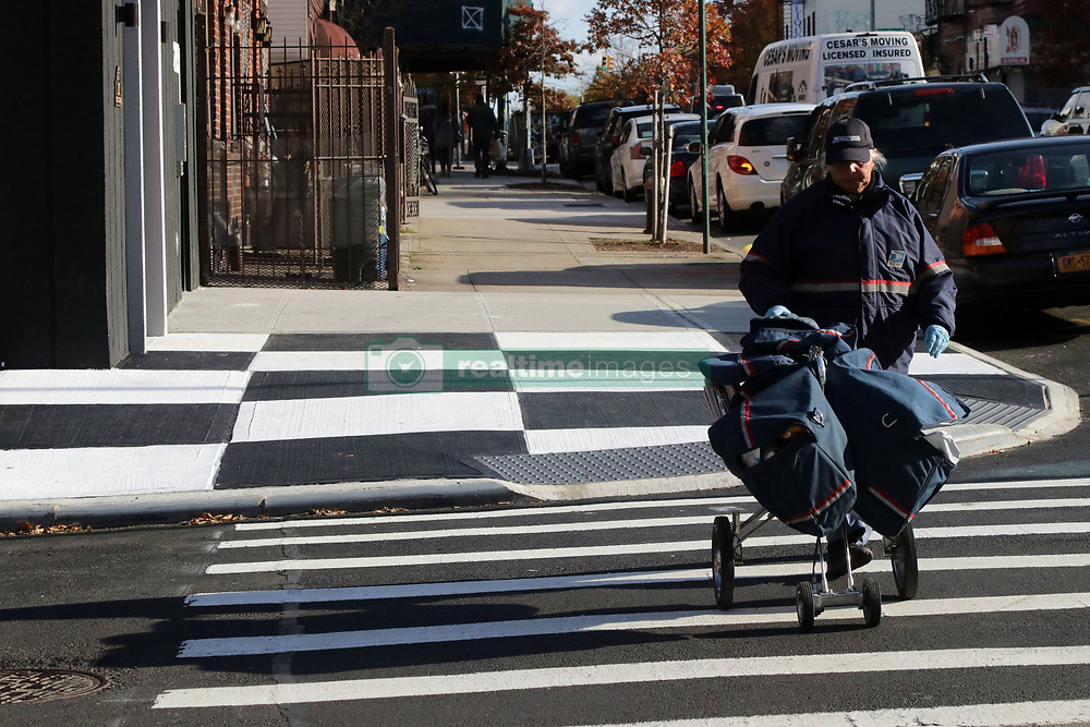 November 10, 2018 - New York City, New York, US - A stretch of a Brooklyn, New York sidewalk, has been transformed into a checkerboard of black and white squares across a patch of pavement outside a fancy new apartment building and store RISK Boutique and Gallery in the rapidly gentrified neighborhood of Bushwick. The Department of Transportation says people cannot legally paint sidewalks and unauthorized artistry typically receives a fine, with property owners usually get 30 days to remove their work before an official penalty follows. (Credit Image: © G. Ronald Lopez/ZUMA Wire)