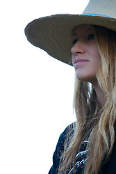 Cowgirl, Cydnie Clark, after a day of driving   cows in Alpine Wyoming