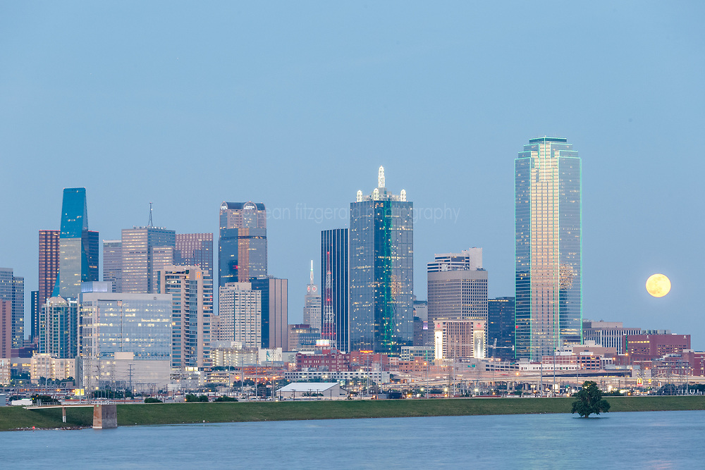 View of downtown and full moon during Trinity River flood, Dallas, Texas, USA
