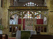 Church at Berkeley, Gloucestershire, 15th century ornate stone rood screen Perpendicular tracery and chancel arch